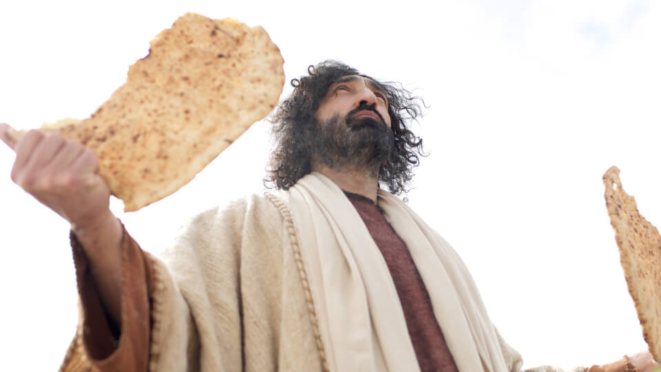 Jesus breaks bread and gives thanks